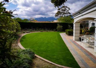 Clay Pavers with Charcoal inlays with Artificial Grass inlay