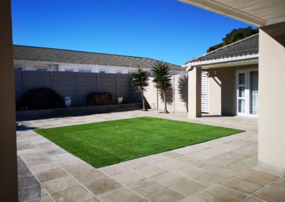 Sandstone Pavers with Artificial Grass